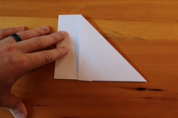 Step 6 — Fold entire airplane in half, outwards.