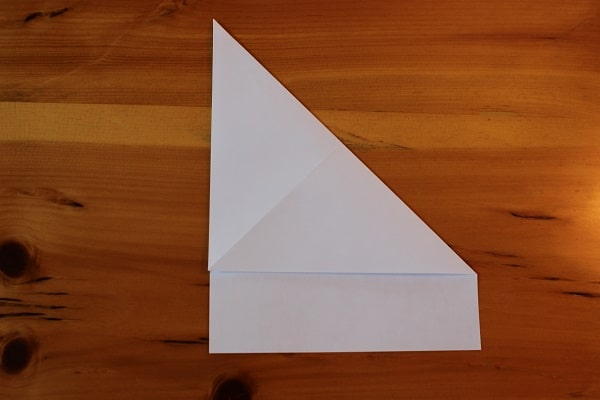 Step 2 — Fold and unfold top right corner to make a crease.