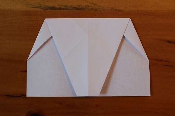 Top half folded down to meet bottom edge.