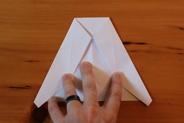 Fold top corners down again so they meet the middle crease.