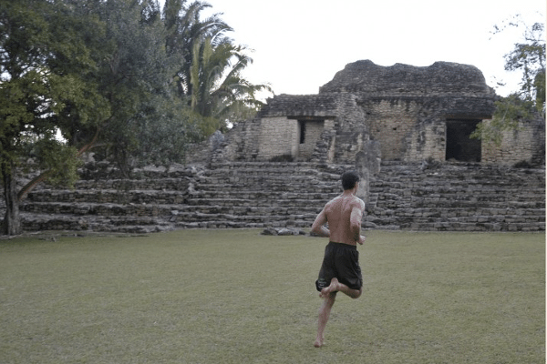 A man jogging in the ancient field.