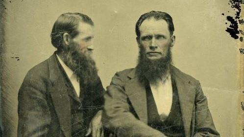 two vintage gentlemen with long beards portrait