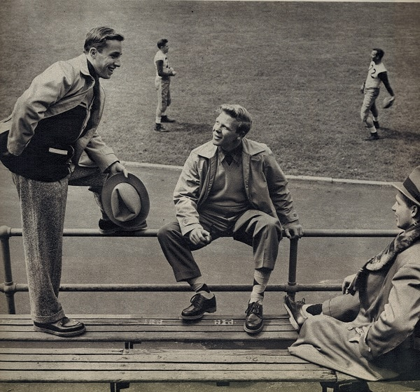 It can get mighty cold up in the stands, no matter how hot the game, and you'll need warm, rugged clothing. Left, a processed lined jacket, a cardigan sweater which comes in school colors, tweed slacks. Next, a poplin zipper jacket with detachable lining, a plaid shirt, long-sleeved sweater, and gabardine slacks. For really cold weather, the alpaca-lined coat with mouton collar. Shoes are the types preferred by students, built for wear.