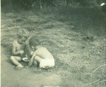 vintage little boys playing in dirt mud