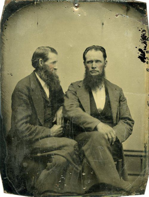 vintage portrait two men with long beards sitting together