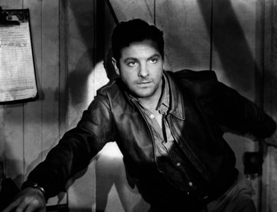 vintage man wearing leather jacket with spotlight on him