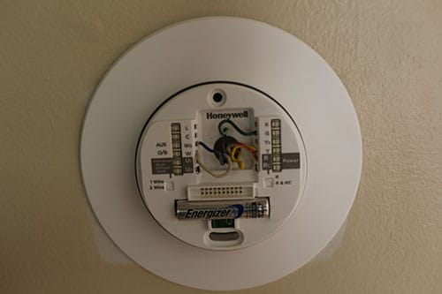 Placing new thermostat on wall.
