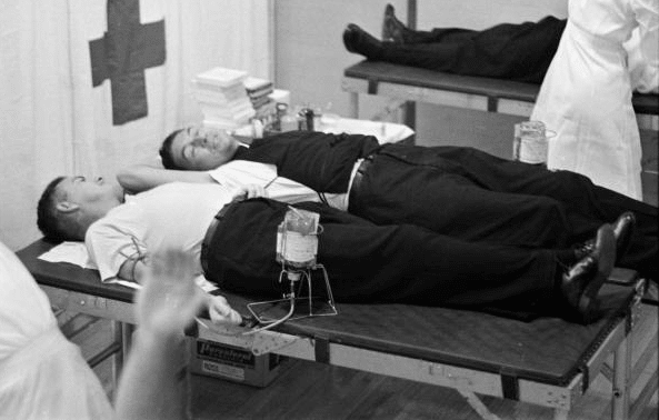 vintage men donating blood at american red cross