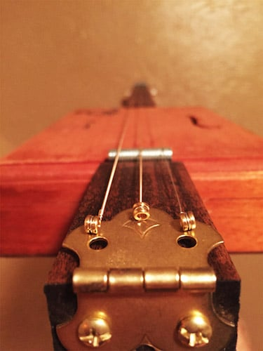 The strings of the metallic wires are attached with tailpiece.