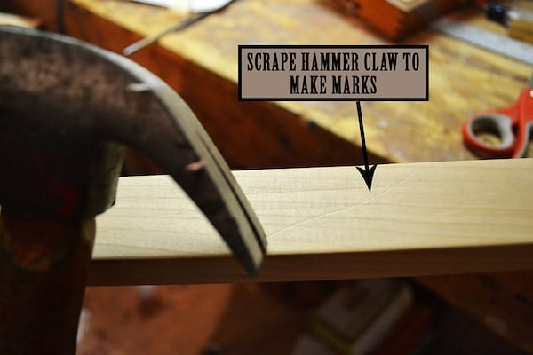 Hitting the nails by using hammer.