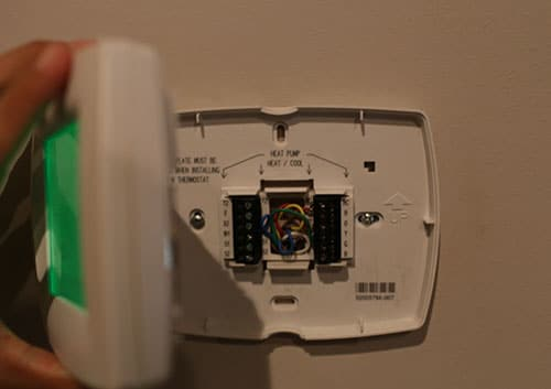 removing cover face of thermostat