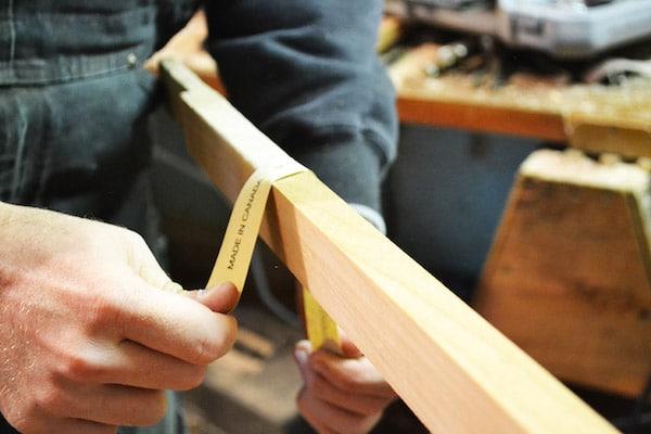 Man measuring the rustic feel of guitar.