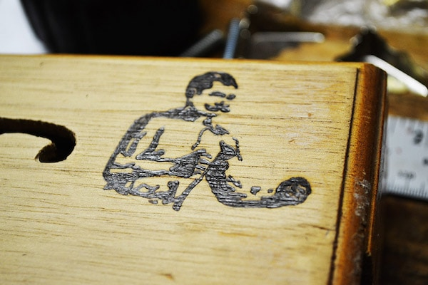 The man logo on cigar box illustration.