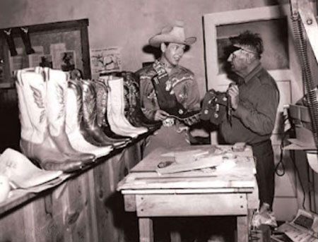 Vintage man shopping for cowboy western boots.