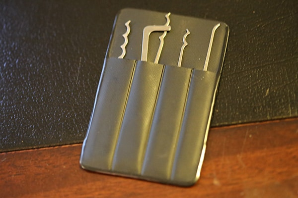 Wallet-sized, titanium made lock pick.