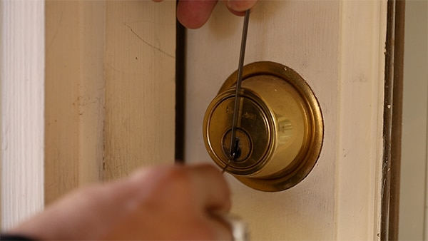 Inserting pick at top of lock.