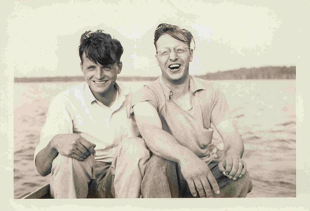 vintage friends laughing on boat on lake