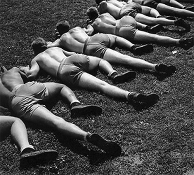 Vintage Soldiers basic Training crawling on ground.