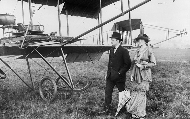 winston and clementine churchill standing next to airplane