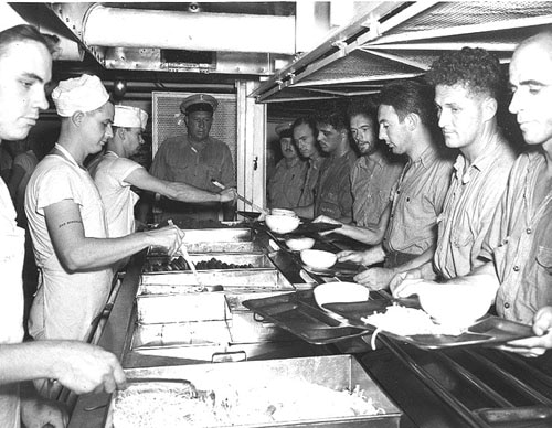 vintage soldiers in mess dining hall being served food