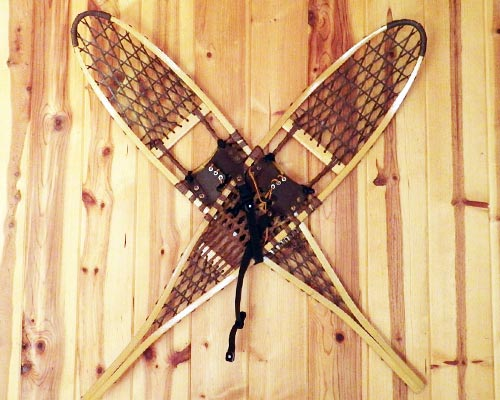 vintage wooden snowshoes hanging on wall