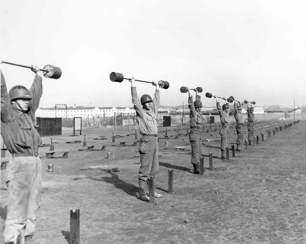 vintage soldiers lifting barbells basic training