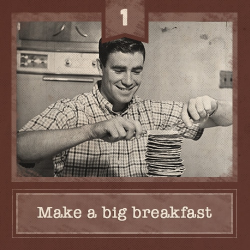 vintage young man eating large stack of pancakes