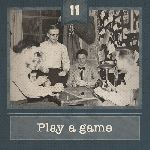 Vintage men sitting around table playing poker.