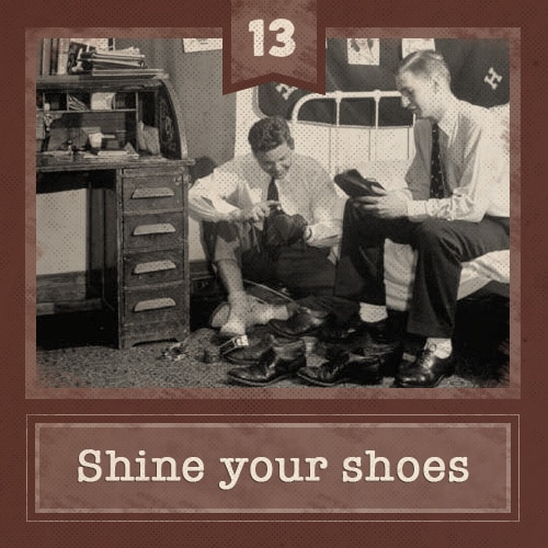 Vintage college men in dorm room shining shoes.