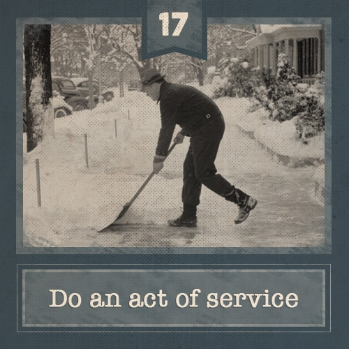 vintage man shoveling sidewalk on snowy day