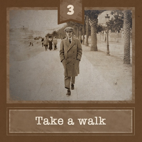 vintage man talking walk on path in winter overcoat