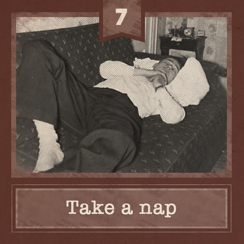 Vintage man napping on couch.