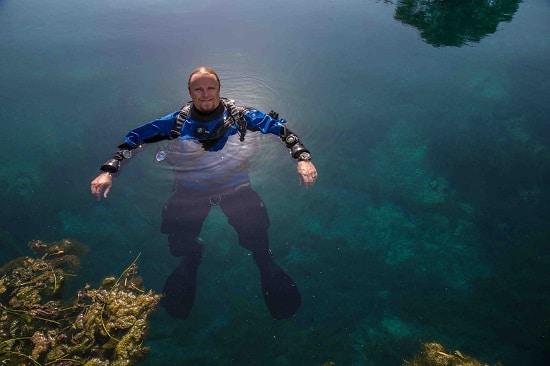 "Frederick ""Fritz"" Hansel man underwater archaeologist in water."