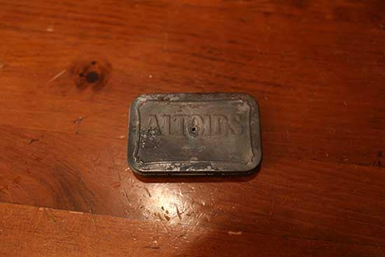 burned altoids tin