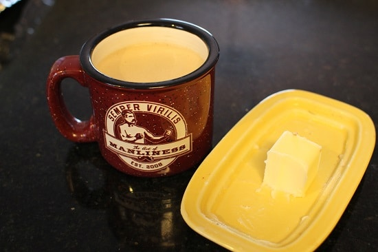 A Cup of Coffee with Cube of Butter.