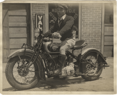 vintage young african american black man on motorcycle