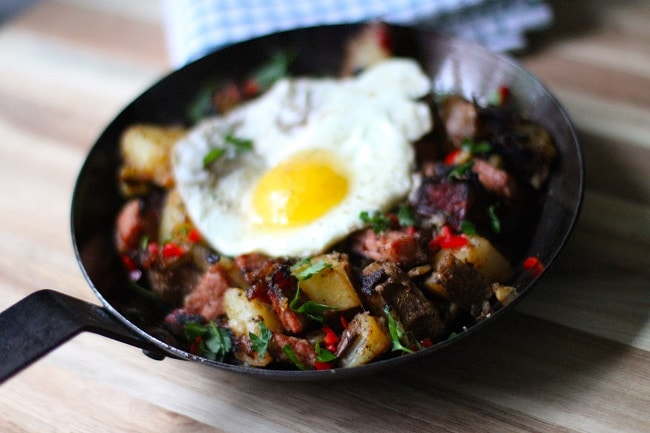 corned Beef Hash with fried egg in cast iron skillet
