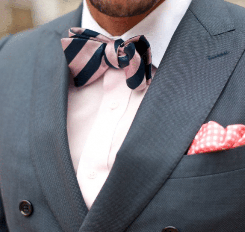 close up man wearing pink striped bowtie