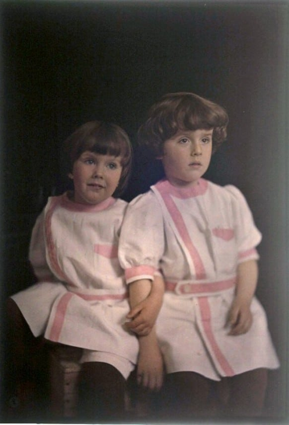 early 1900s young boys portrait wearing pink