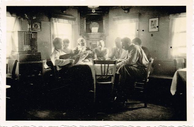 vintage men sitting at dinner table talking