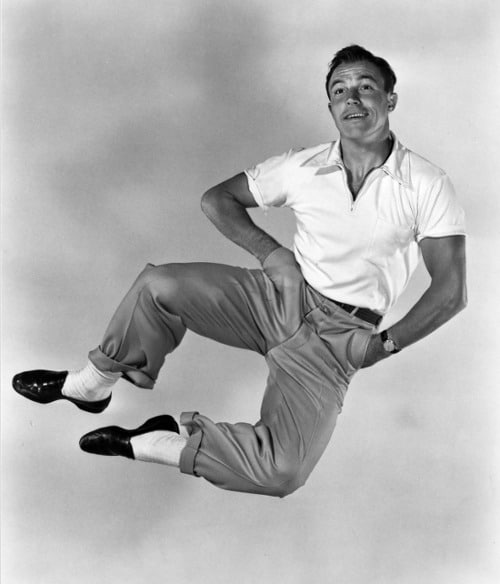 vintage happy go lucky man jumping clicking heels