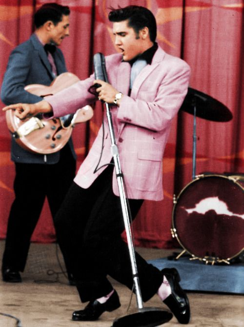 elvis wearing pink blazer singing performing on stage