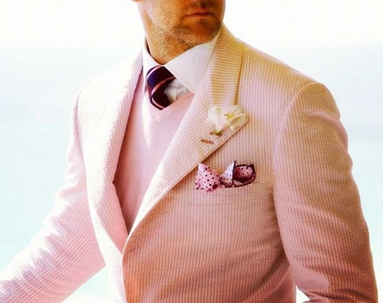 man wearing pink seersucker suit