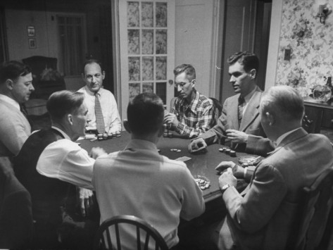 vintage men playing poker in home