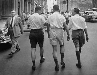 men walking down street wearing shorts - vintage