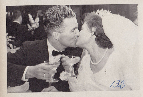 vintage couple kissing on wedding day