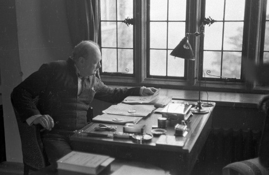 Winston churchill working at desk.