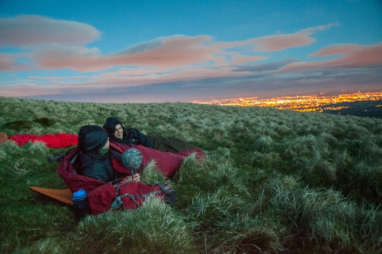 al humphreys in sleeping bag in field of grasses