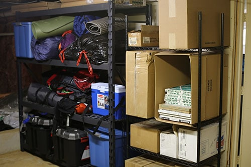 Garage shelves camping and sporting equipment.