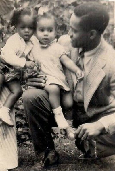vintage african-american father with daughters
